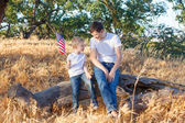Family celebrating 4th of July — Stockfoto