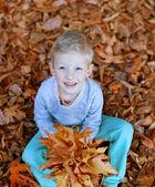 Kid at fall — Stock Photo