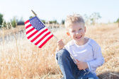 Boy celebrating 4th of July — Stock Photo