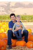 Family at pumpkin patch — Stock Photo