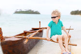 Kid at outrigger canoe — Stock Photo