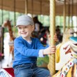 Boy at carousel — Stock Photo #49973123