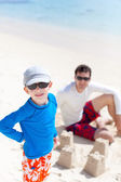 Family building sand castle — Stock Photo