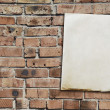 Stock Photo: Paper on brickwall
