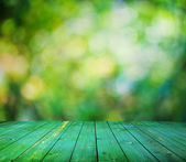 Bright bokeh and wooden floor — Stock Photo