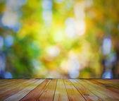 Parlak bokeh ve ahşap zemin — Stok fotoğraf