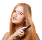 Girl with comb — Stock Photo