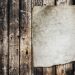 Paper on old wood texture — Stock Photo #26288093