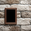 Stock Photo: Photo frame on brick wall