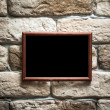 Photo frame on brick wall — Stock Photo #31537887