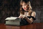 Woman and vintage typewriter — Stock Photo