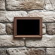 Photo frame on brick wall — Stock Photo #35436723