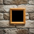 Photo frame on brick wall — Stock Photo #35436733