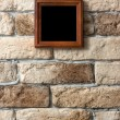 Photo frame on brick wall — Stock Photo #35436737