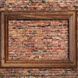 Photo frame on brick wall — Stock Photo