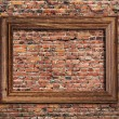 Photo frame on brick wall — Stock Photo #35437863