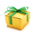 Yellow box with a green bow — Stock Photo
