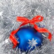 Blue Christmas ball with red ribbon — Stock Photo