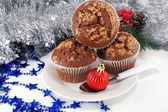 Three chocolate cake on a plate and christmas — Stock Photo