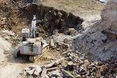 Excavator machine doing earthmoving work — Stock Photo