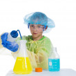 Boy in protective clothing to conduct experiments with smoke - Stock Photo