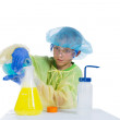Stock Photo: Boy spends experiments mixing different fluids and smoke gets