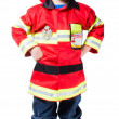 A happy four-year boy in the costume of fireman - Stock Photo