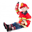 Funny boy in fireman costume with a helmet to go off the side — Stock Photo