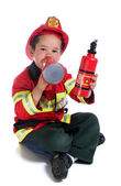 The five-year boy in fireman costume — Stock Photo