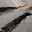 Stock Photo: Large cracks in road, destruction of roadway