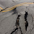 Stock Photo: Earthquake - destruction of road crack