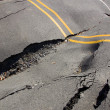 Stock Photo: Dip in road surface and cracks in asphalt
