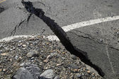 A crack in the pavement, the destruction of the road — Stock Photo