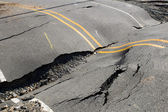 Cracks in the road, roadway violation — Stockfoto