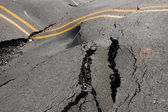 Earthquake - the destruction of the road crack — Stock Photo