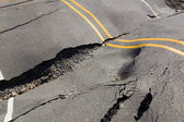 A dip in the road surface and the cracks in the asphalt — Stock Photo