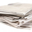 A stack of newspapers isolated on white background — Stock Photo