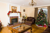 Christmas Tree in the interior with a fireplace — Stock Photo