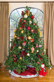 Christmas tree against the window — Stock Photo