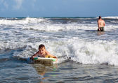 Joyful child on the board is racing with the wave. Bodyboarding — Stock Photo