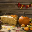 Stock Photo: Apples and pumpkins on wooden background