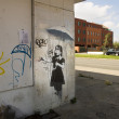 Girl with an umbrella. Graffiti by Banksy in New Orleans — Stock Photo