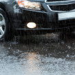 Car in a downpour — Stock Photo