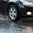 Car on flooded street — Stock Photo #12944132