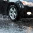 Stock Photo: Car on flooded street