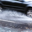 Driving in flood water - Stock Photo