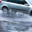 Car in downpour — Stock Photo #13818550