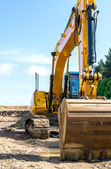 Front of yellow backhoe — Stock Photo
