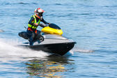 Woman riding jet ski — Stock Photo
