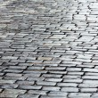 Stock Photo: Wet cobbled road